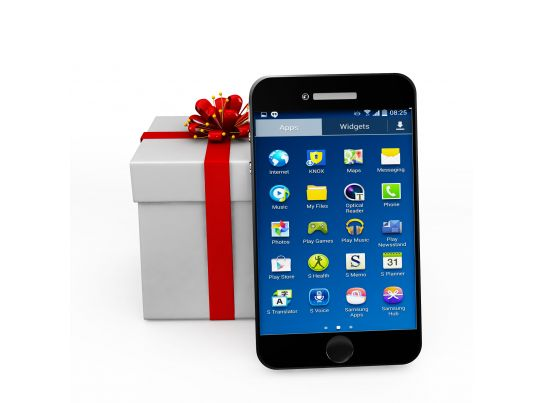 mobile phone with gift box showing phone as gift stock