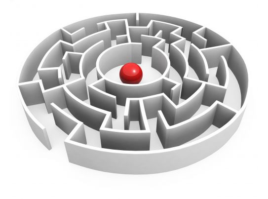 red ball in maze center showing leadership stock photo