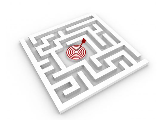 square maze with target dart in the middle stock photo