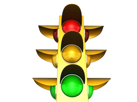 traffic light with red green and yellow lights stock photo
