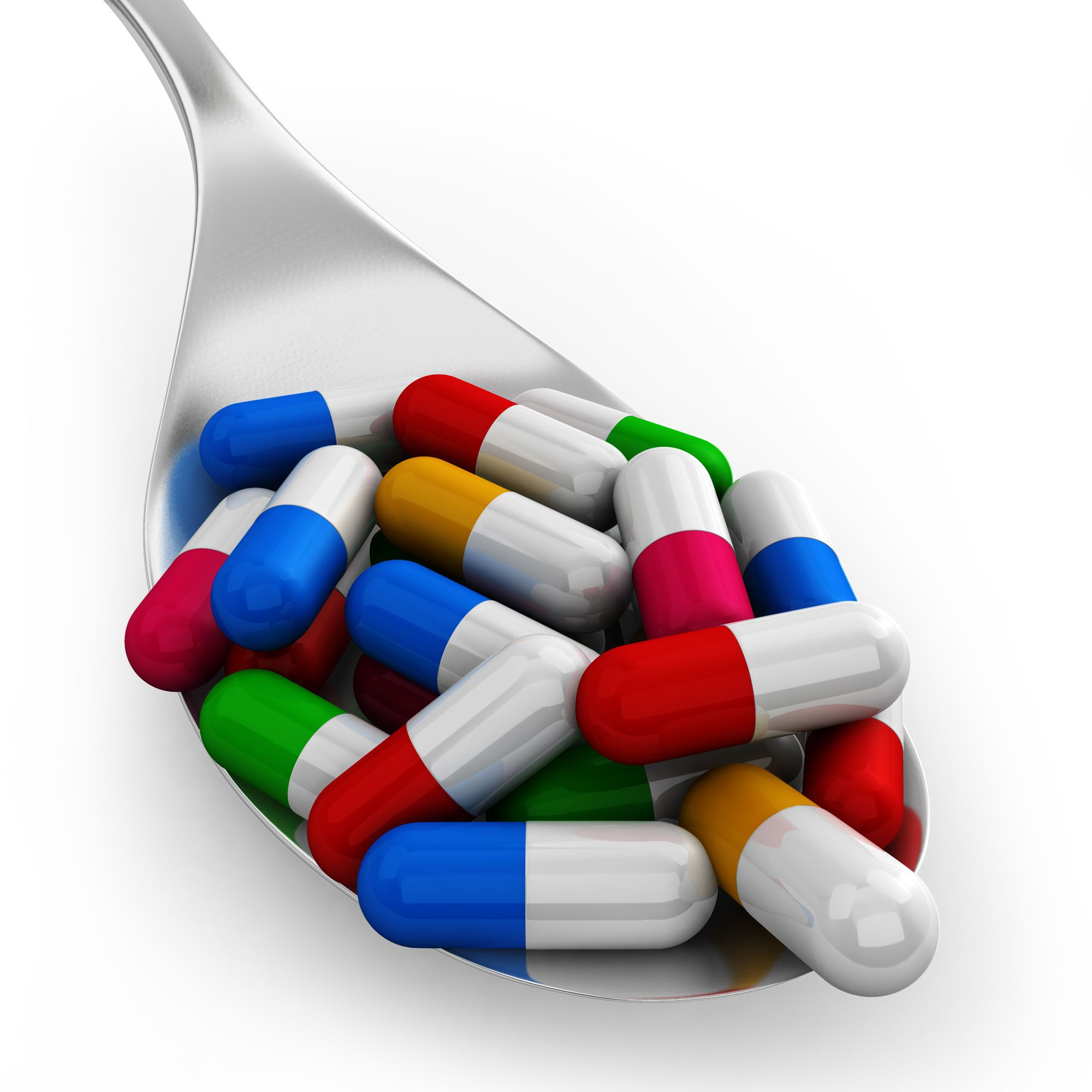 0914_colorful_capsules_on_silver_spoon_for_healthcare_stock_photo_Slide01