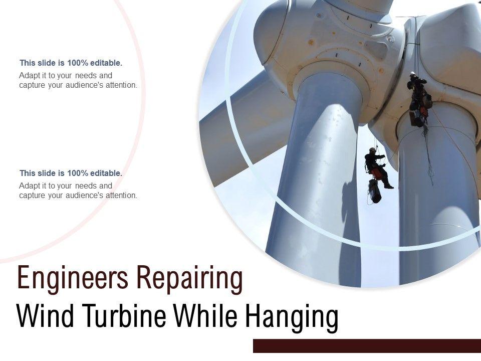 Engineers Repairing Wind Turbine While Hanging