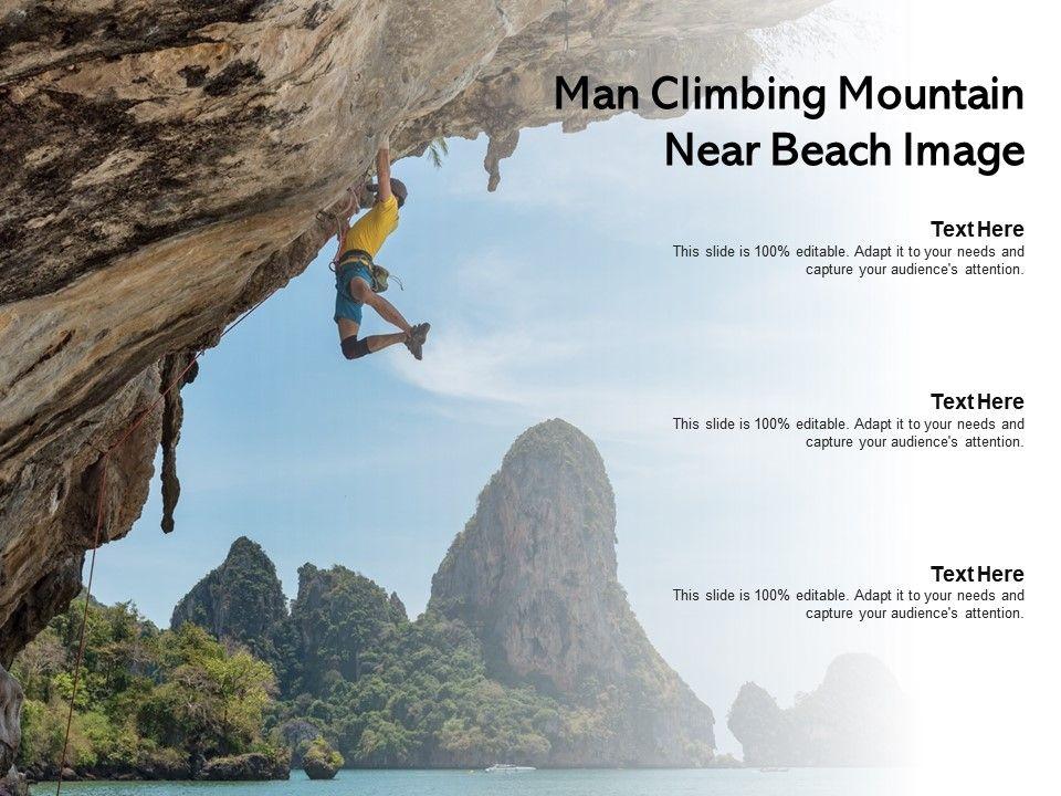 Man Climbing Mountain Near Beach Image