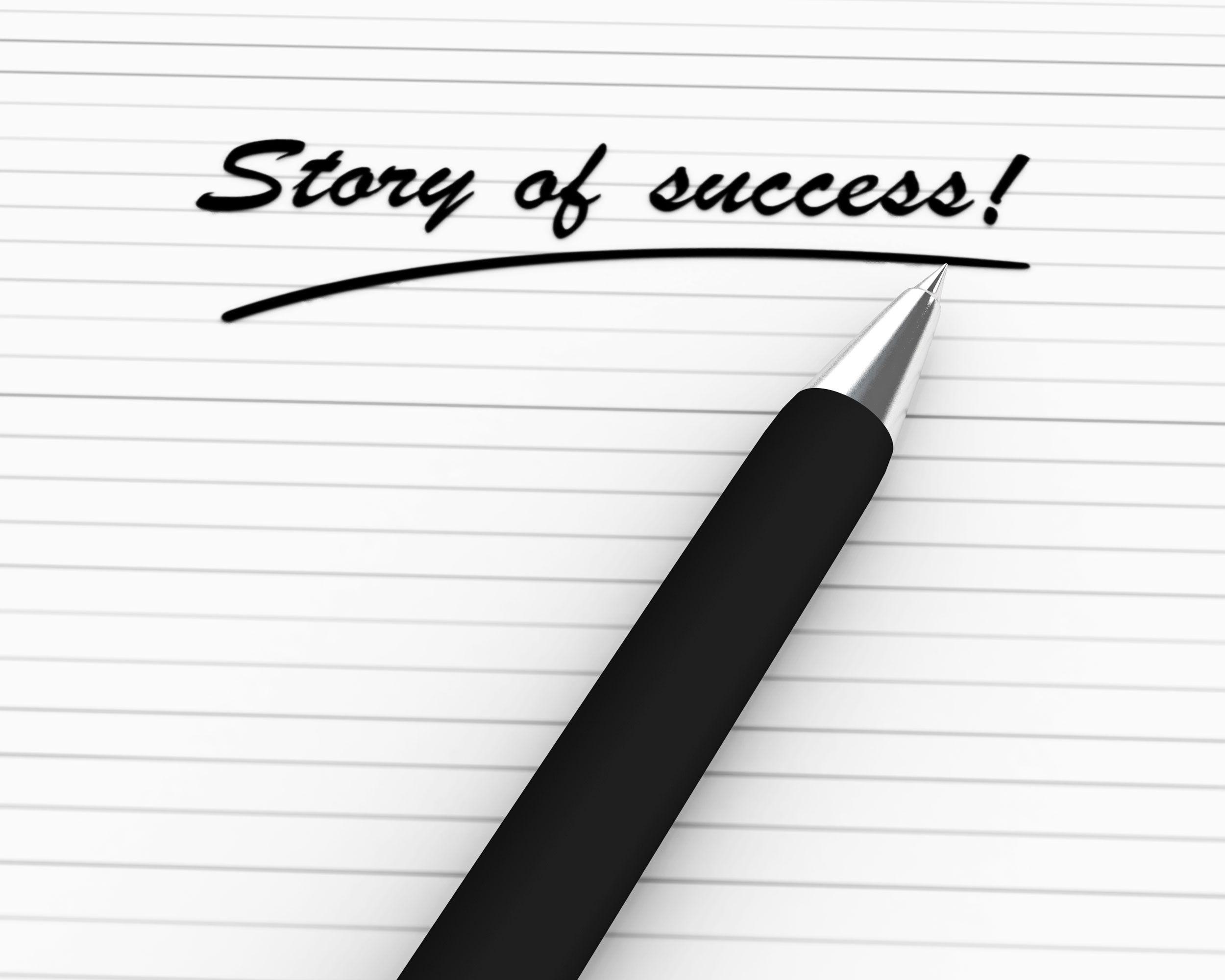 pen_writing_story_of_success_stock_photo_Slide01