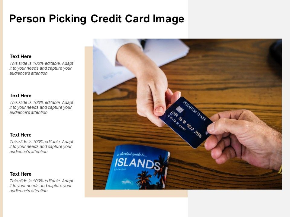 Person Picking Credit Card Image