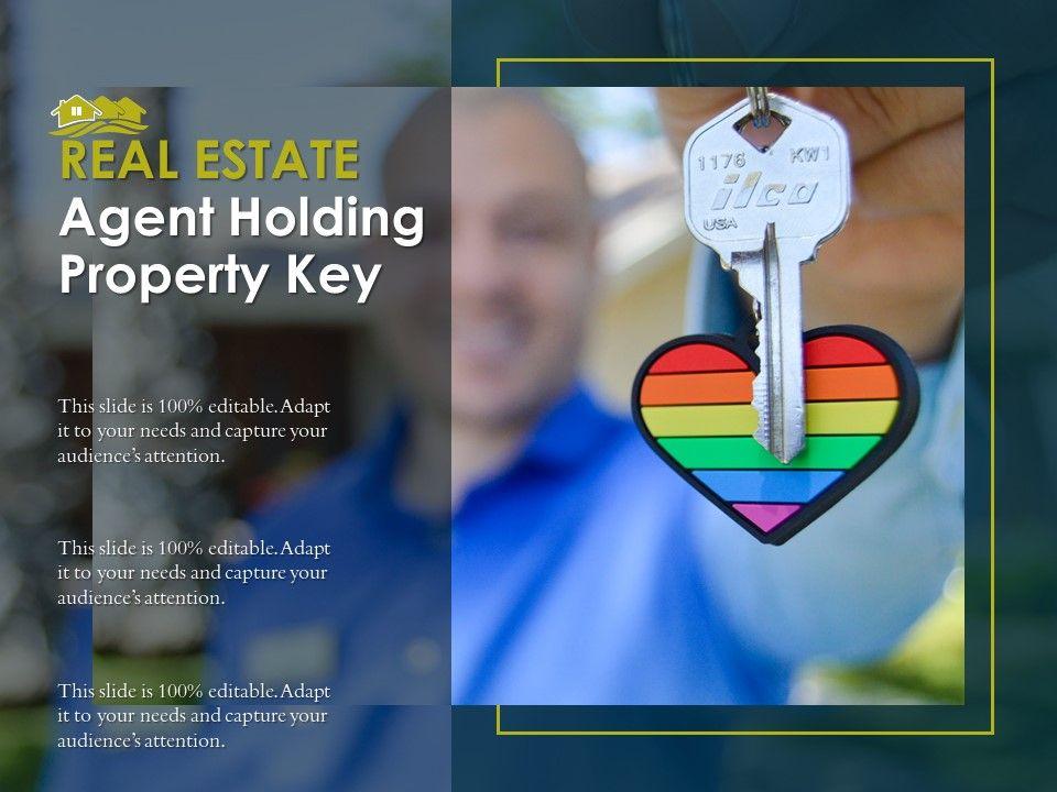 Real Estate Agent Holding Property Key